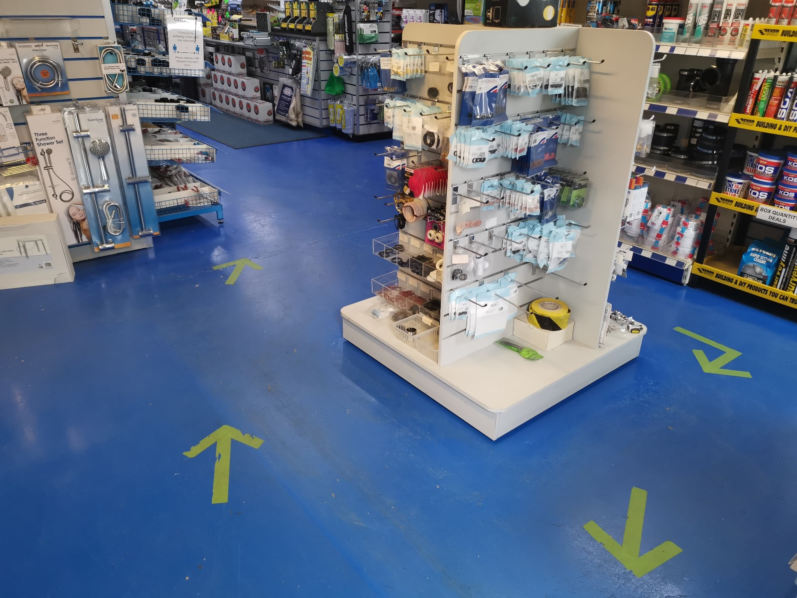 arrows on the floor indicating direction of travel in store